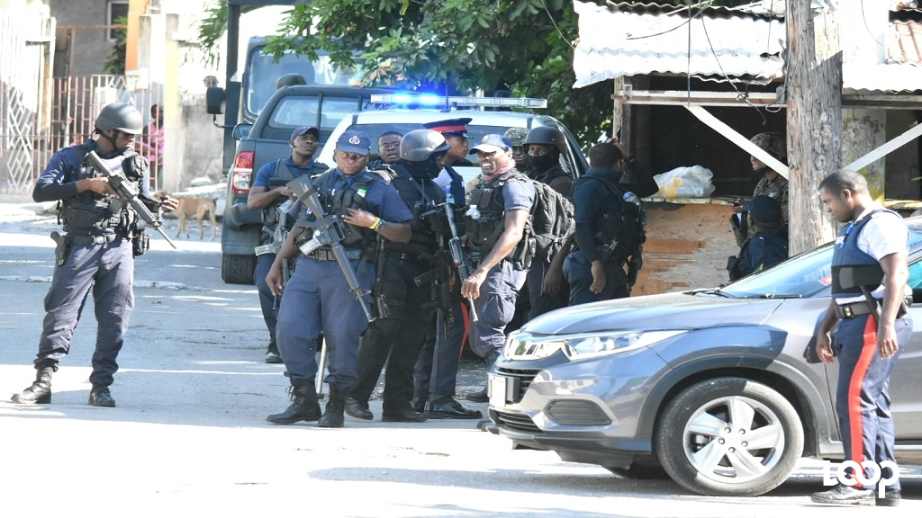 Police officers in Swallowfield, St Andrew on Friday morning. (Photos: Marlon Reid)