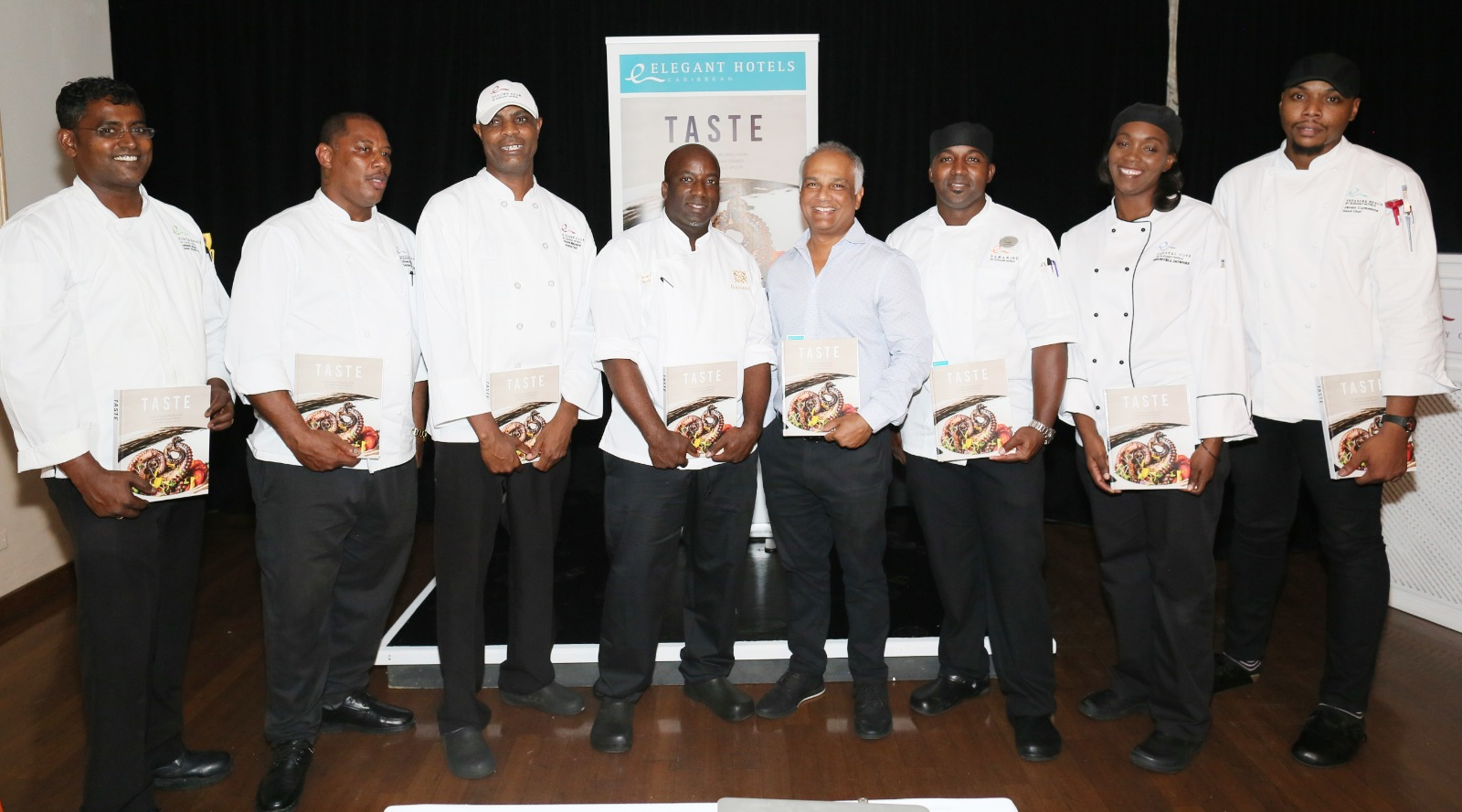 Elegant Hotels Group CEO Sunil Chatrani (centre) with the seven Executive Chefs featured TASTE, the company's first cookbook.