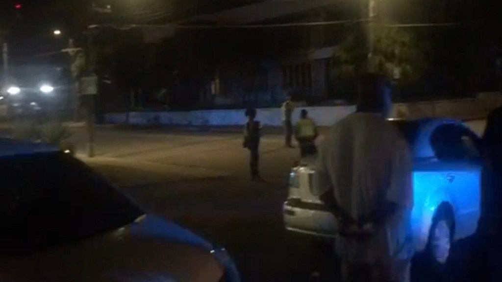A screen grab from a video of the scene where two alleged robbers were shot - one fatally - by a cop in Cross Roads, St Andrew on Friday night.