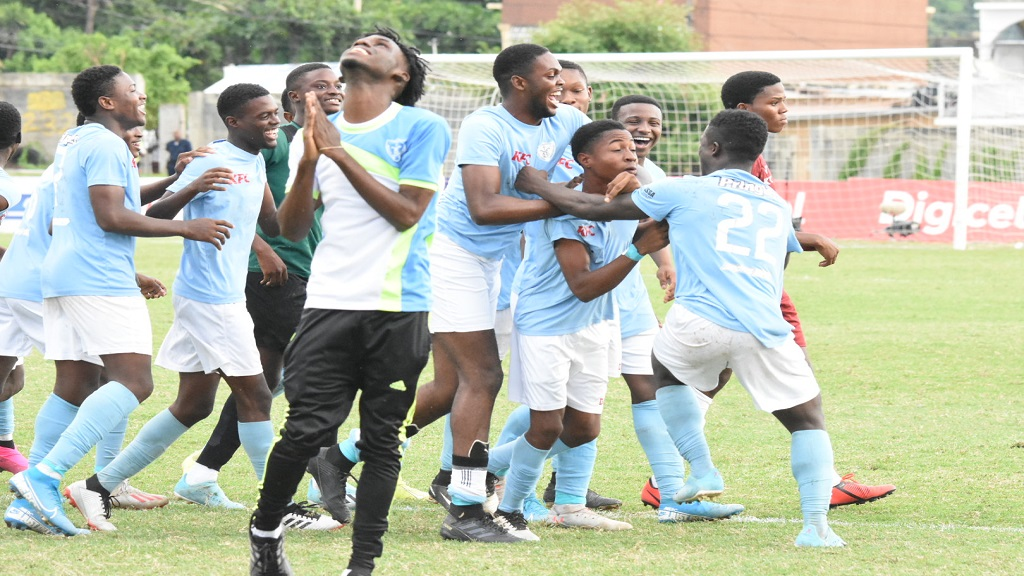 St Catherine High School players  celebrate after securing a 5-4 penalty shoot-out victory over St George's College in their ISSA/Digicel Walker Cup semi-final match at the Stadium East field on Thursday, November 21, 2019. (PHOTO: Marlon Reid).