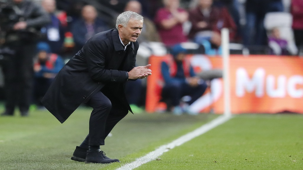 Tottenham's manager Jose Mourinho calls out to his players during the English Premier League football match against West Ham, at London stadium, in London, Saturday, Nov. 23, 2019.(AP Photo/Frank Augstein).