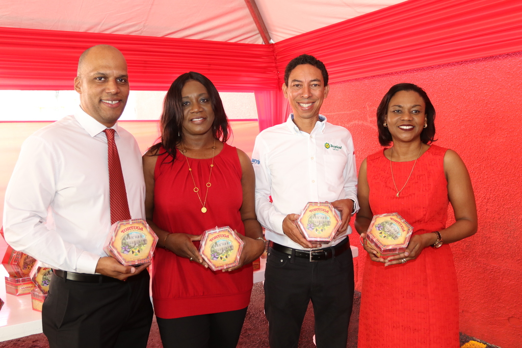 From left: Tortuga International Holdings Ltd Managing Director Marcus Simmonds; Tortuga International Holdings Ltd Head of Manufacturing Florence Reid; JP Tropical Group Managing Director David Martin; and JP Tropical Group Financial Controller Antoinette Livingston display the newly released Jamaican Rum Fruit Cake during the staff launch held at Tortuga Jamaica Head Office on Monday.