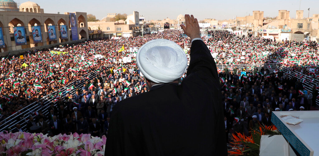 In this photo released by the official website of the office of the Iranian Presidency, President Hassan Rouhani waves to the crowd in a public gathering at the city of Yazd, some 410 miles (680 kilometers) southeast of the capital Tehran, Iran, Sunday, Nov. 10, 2019.