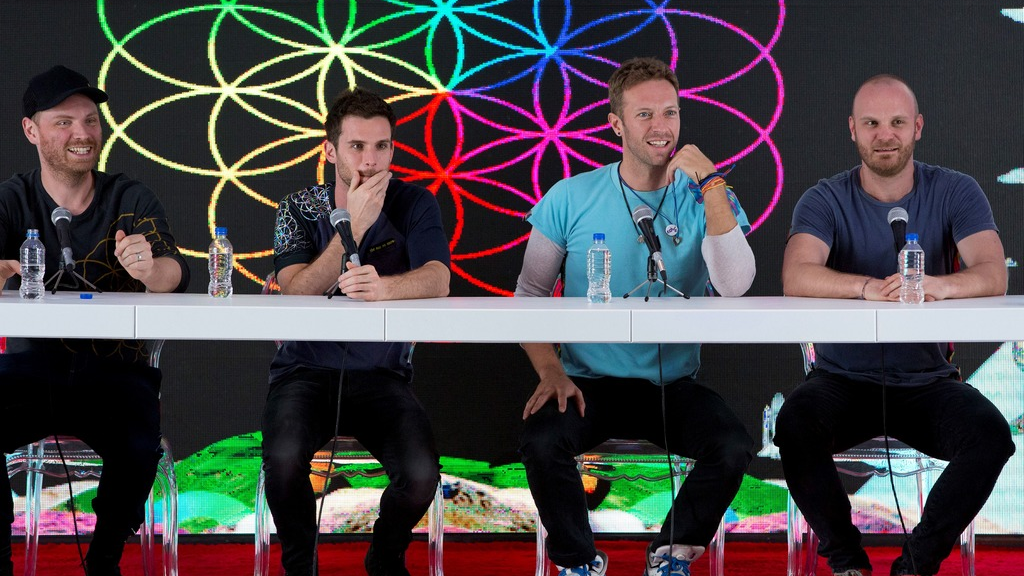 In this Friday, April 15, 2016 file photo, members of British band Coldplay, from left, Jonny Buckland, Guy Berryman, Chris Martin, and Will Champion, participate in a press conference at Foro Sol in Mexico City. The British band Coldplay has decided not to launch a global tour because of environmental concerns. (AP Photo/Rebecca Blackwell, file)