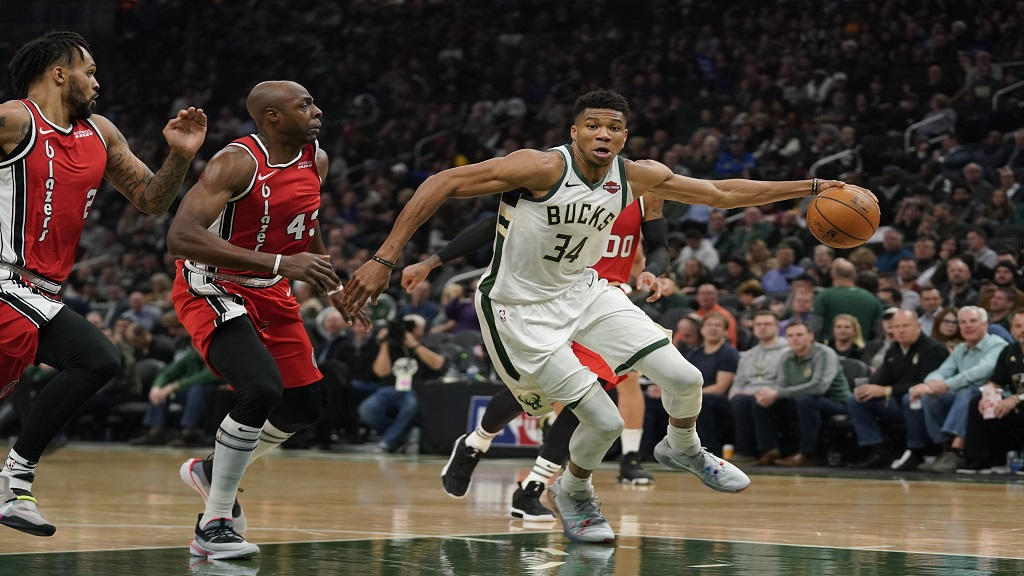 Milwaukee Bucks' Giannis Antetokounmpo drives past Portland Trail Blazers' Anthony Tolliver during the first half of an NBA basketball game Thursday, Nov. 21, 2019, in Milwaukee. (AP Photo/Morry Gash).