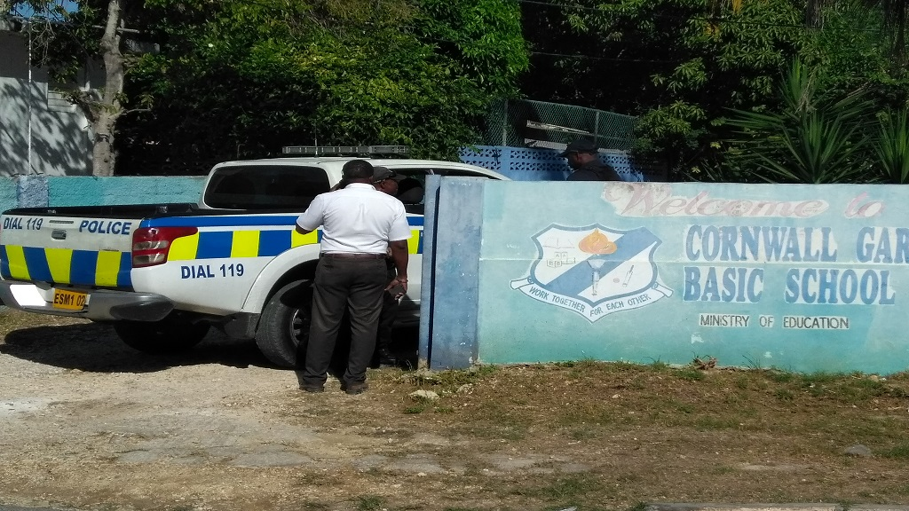 Police at the entrance of the Cornwall Gardens Basic School in Mount Salem, where a father was shot dead as he dropped off his child on Wednesday morning.