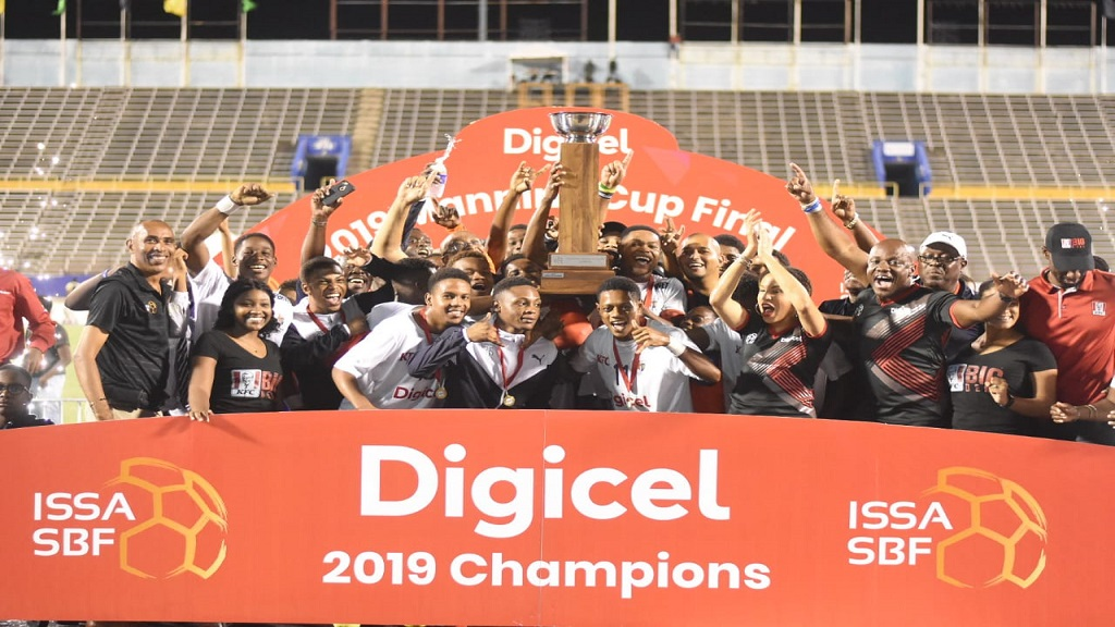 Jamaica College players, officials and representatives of the sponsors celebrate with the ISSA/Digicel Manning Cup after defeating St Andrew Technical High School (STATHS) 5-4 in a penalty shoot-out in the final on Friday, November 29, 2019 at the National Stadium. (PHOTOS: Marlon Reid).