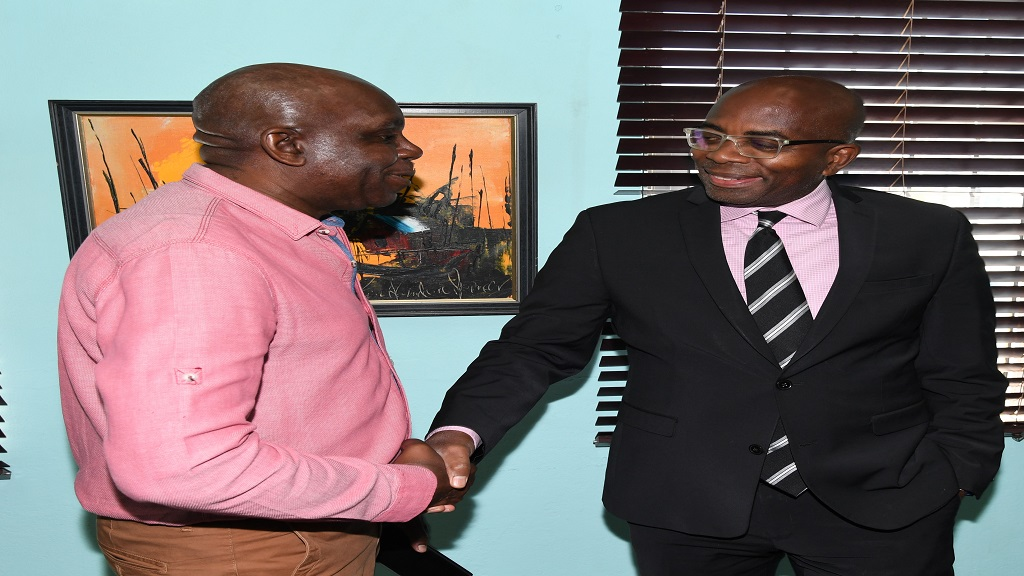 Curtis Martin (right), managing director of JN Bank, is greeted by Kenarthur Mitchell, commercial and financial manager at Edge Chem, following a recent breakfast meeting at the Jamaica Manufacturers and Exporters Association (JMEA) headquarters in downtown, Kingston.