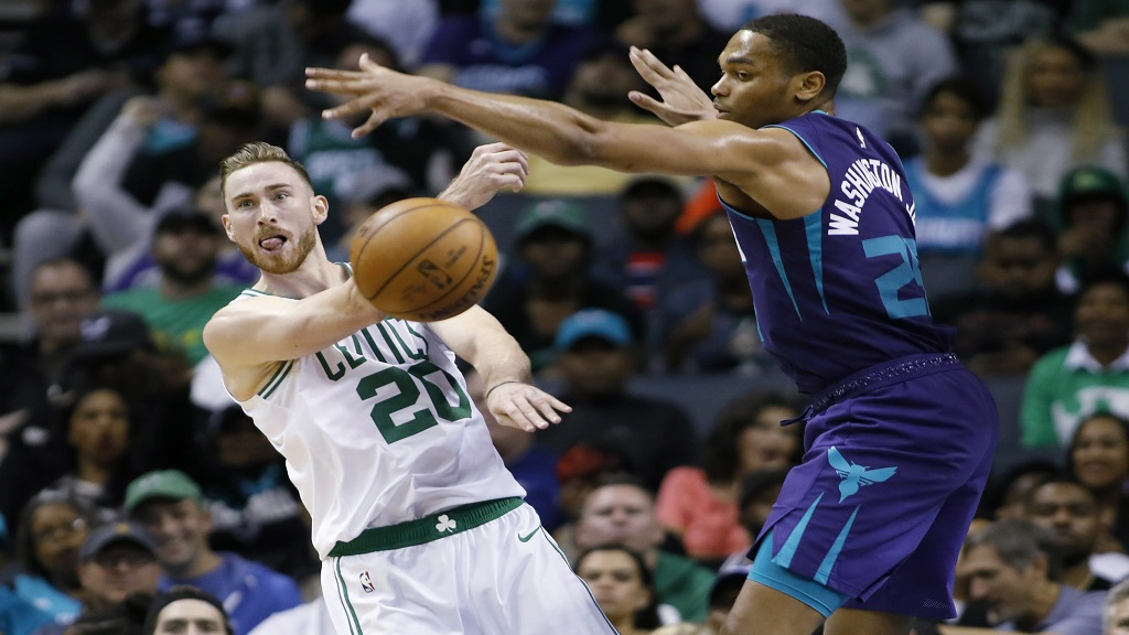 Boston Celtics' Gordon Hayward (20) gets a pass off against Charlotte Hornets' P.J. Washington (25) during the second half of an NBA basketball game in Charlotte, N.C., Thursday, Nov. 7, 2019. The Celtics won 108-87. (AP Photo/Bob Leverone).