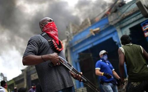 Des personnes cagoulées en Haïti. Crédit photo: HPN