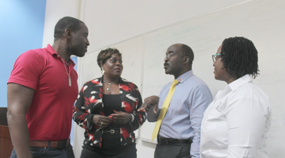 (L-R) UWI Lecturer, Dwayne Devonish; Senior Research Officer with the CJRPU, Kim Ramsay, BDF Chief of Staff, Colonel Glyne Grannum and  CJRPU Director, Cheryl Willoughby