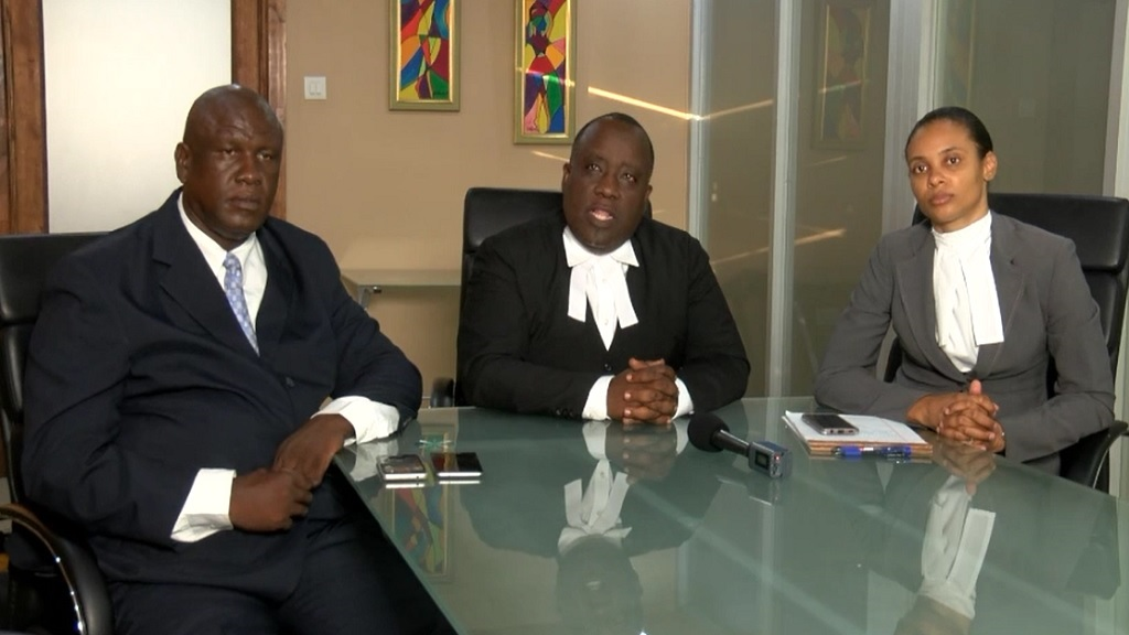 JLP councillor and businessman, Christopher Townsend (left) with his namesake defense attorney Christopher Townsend and attorney Kaysian Kennedy.