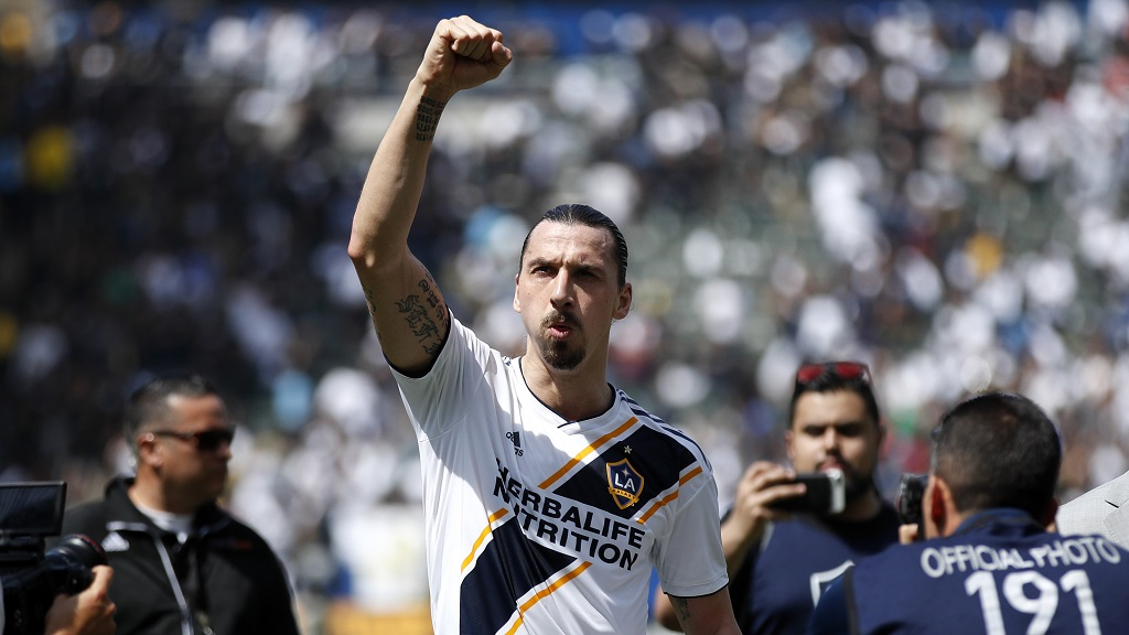 In this March 31, 2018 file photo Los Angeles Galaxy's Zlatan Ibrahimovic, of Sweden, acknowledges fans as he walks off the field after an MLS football match against the Los Angeles FC in Carson, Calif.  (AP Photo/Jae C. Hong, file).