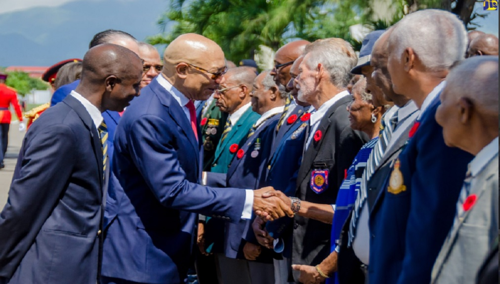 Governor-General, Sir Patrick Allen (second left), greeting former World War II servicemen and servicewomen at last year's Remembrance Day wreath-laying ceremony at National Heroes Park in Kingston.