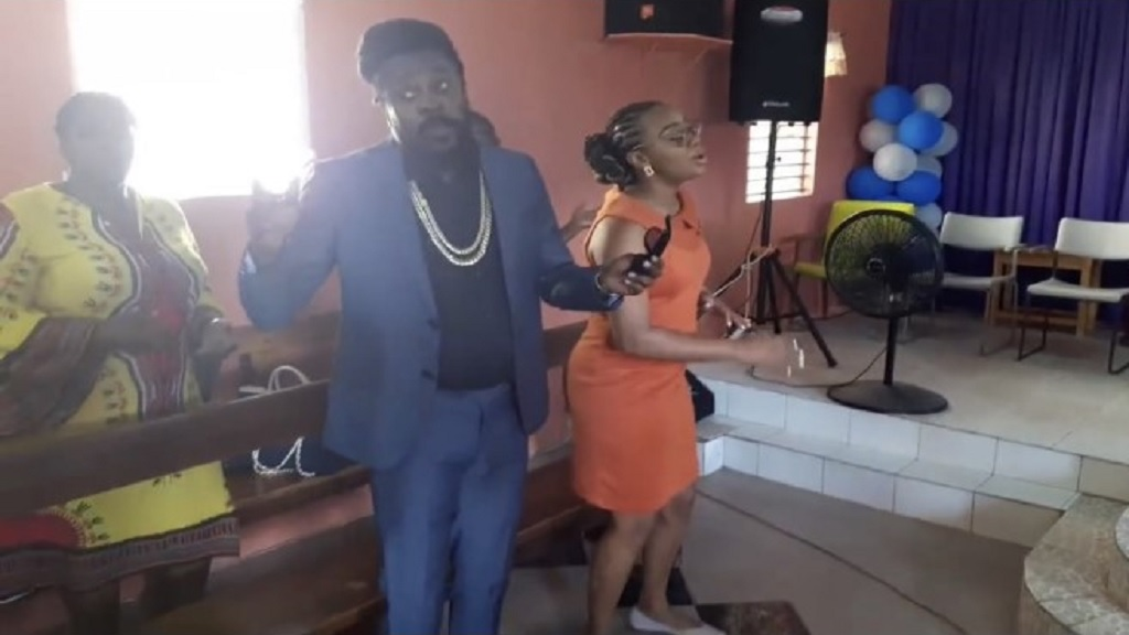 Beenie Man and his spouse, Krystal Tomlinson, lead the congregation in songs.