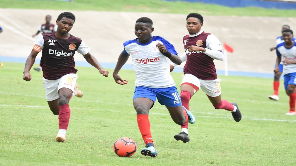 Shaqueil Bradford (right) of Camperdown High dribbles away from Shamour McLean of Wolmer's Boys during their opening Group G quarter-final match of the 2019 ISSA/Digicel Manning Cup football competition at the National Stadium on Wednesday, October 30. Wolmer's won 3-2. (PHOTOS: Marlon Reid).