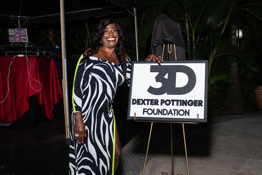 Pottinger's mum Estrie Williams unveils the DPF brand logo. (Photos: DavyFreshh)