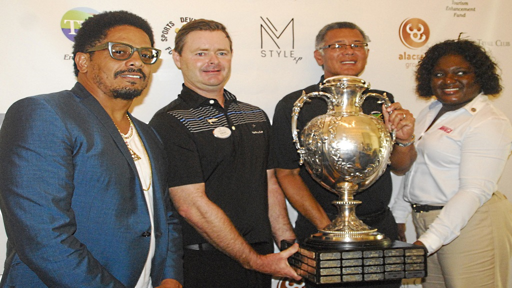 From left: Rohan Marley, co-chair of major sponsor Alacran Foundation;  Ewan Peebles, director of golf at Tryall Club;  Peter Chin, president of the Jamaica Golf Association and  Carlene Moore, a representative from the Jamaica Tourist Board and the Tourism Enhancement Fund, pose with the Jamaica Open trophy during the tournament launch at the Tryall Club.