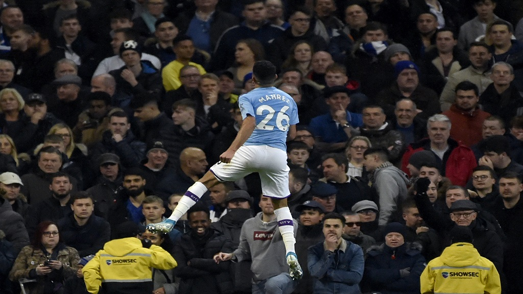 Manchester City's Riyad Mahrez celebrates after scoring his side's second goal during the English Premier League football match against Chelsea at Etihad stadium in Manchester, England, Saturday, Nov. 23, 2019. (AP Photo/Rui Vieira).