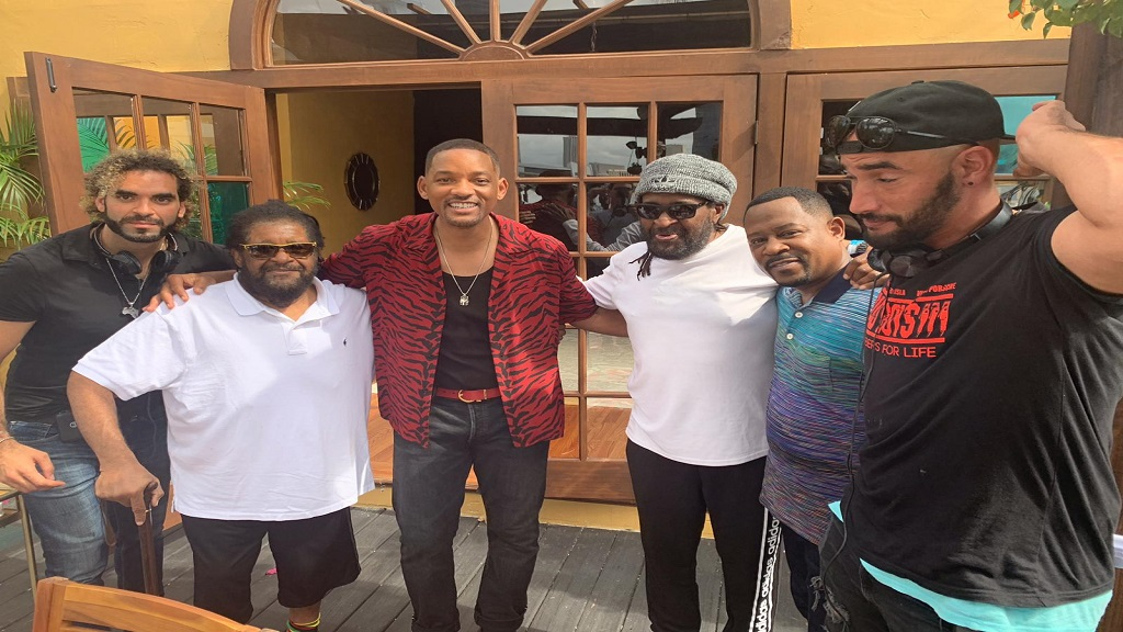 Will Smith and Martin Lawrence, co-stars of the movie Bad Boys For Life, hang out with Roger (second from left) and Ian Lewis (third from left) of Inner Circle, at Island Gardens in Miami on Monday. Bilall Fallah (left) and Adil El Ardi, co-directors of the film, are at left and right, respectively. The movie, which has Inner Circle's song Bad Boys as part of its soundtrack, opens in January. (Photo: contributed)