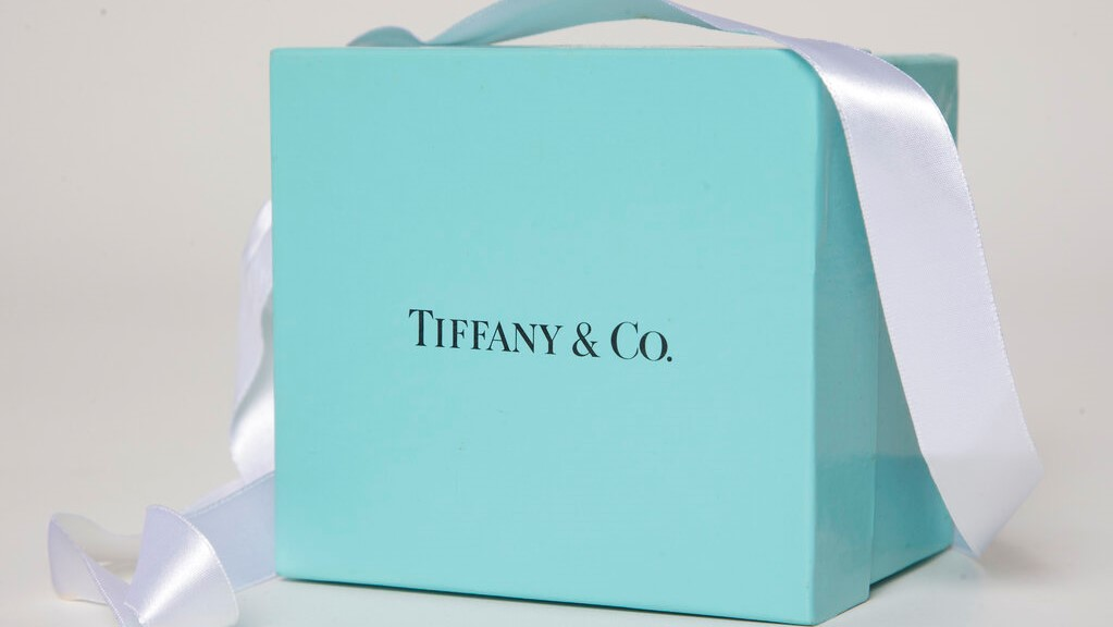 In this May 22, 2017 file photo, a gift box from Tiffany & Co. is arranged for a photo in Surfside, Fla. (AP Photo/Wilfredo Lee, File)