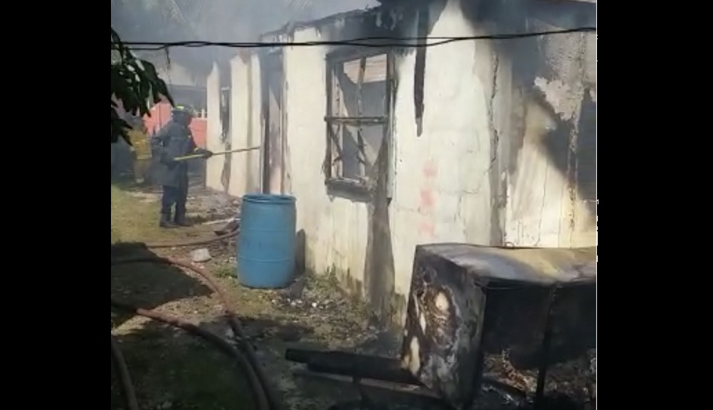 A firefighter battles the blaze at the house.