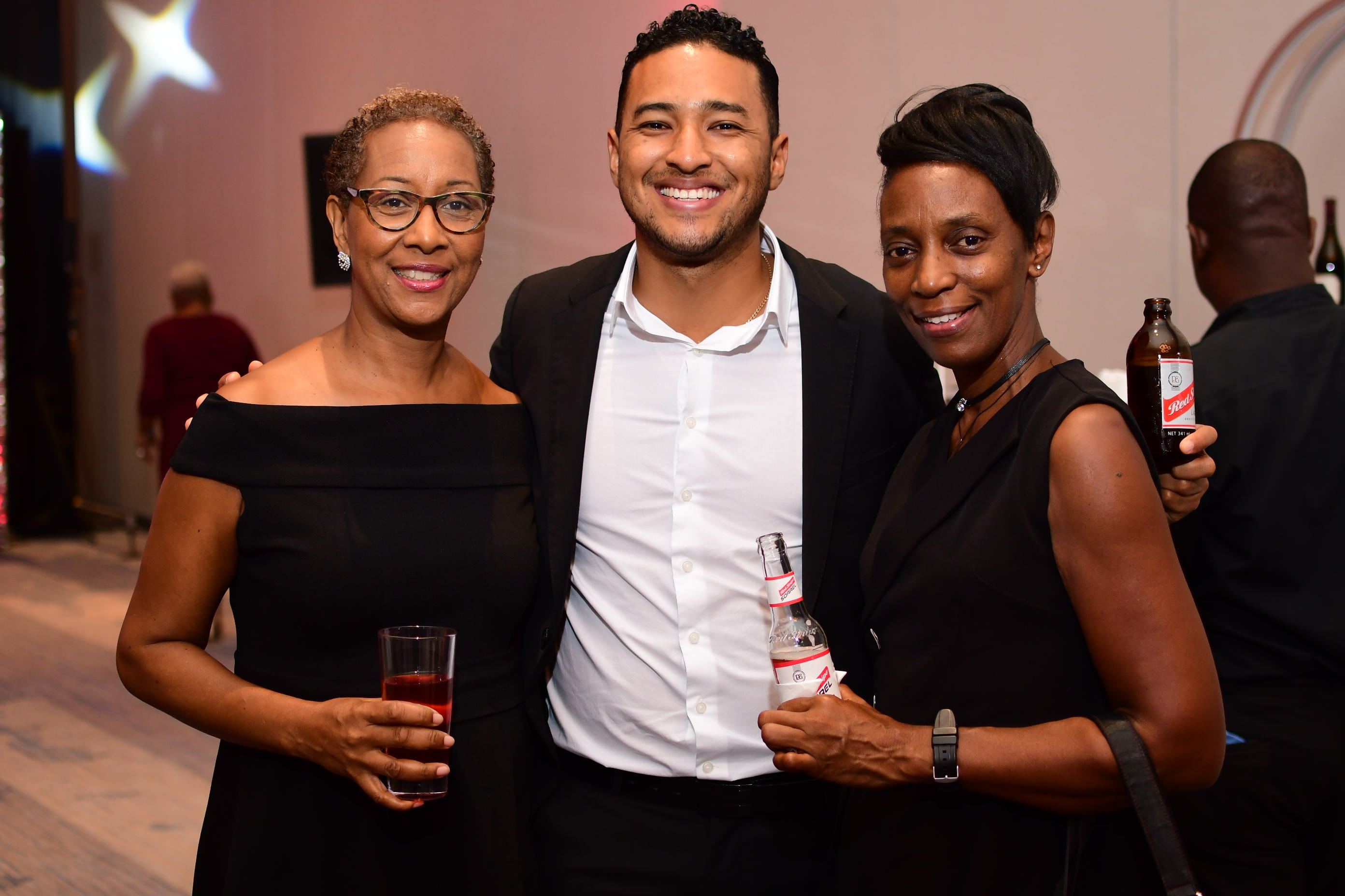 Red Stripe team members (from left) Caroline Kelly, merchandising manager; Andrew Anguin, brand manager, Red Stripe and Innovation; and Ladene Jones-Mitchell, commerce & support services administrator, drink and party responsibly.