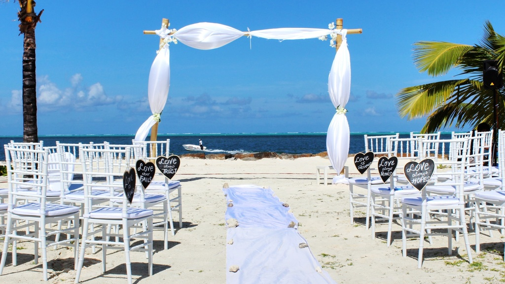 Stock image of beach wedding by Arshad Pooloo on Unsplash