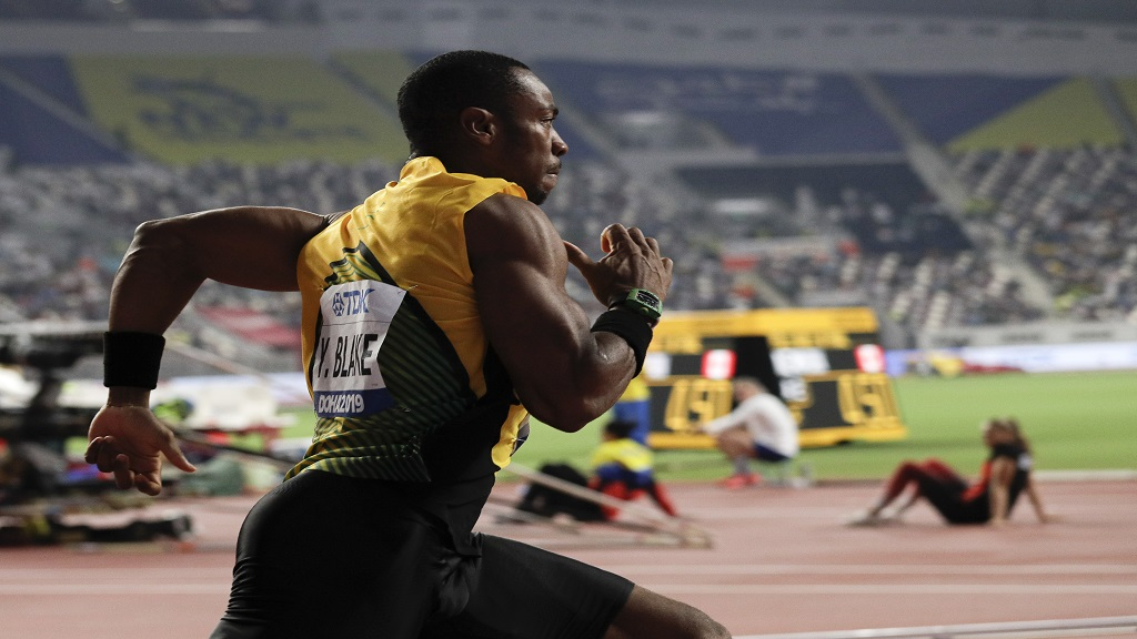 Yohan Blake, of Jamaica races in the men's 200m heats at the World Athletics Championships in Doha, Qatar, Sunday, Sept. 29, 2019. (AP Photo/Nariman El-Mofty).