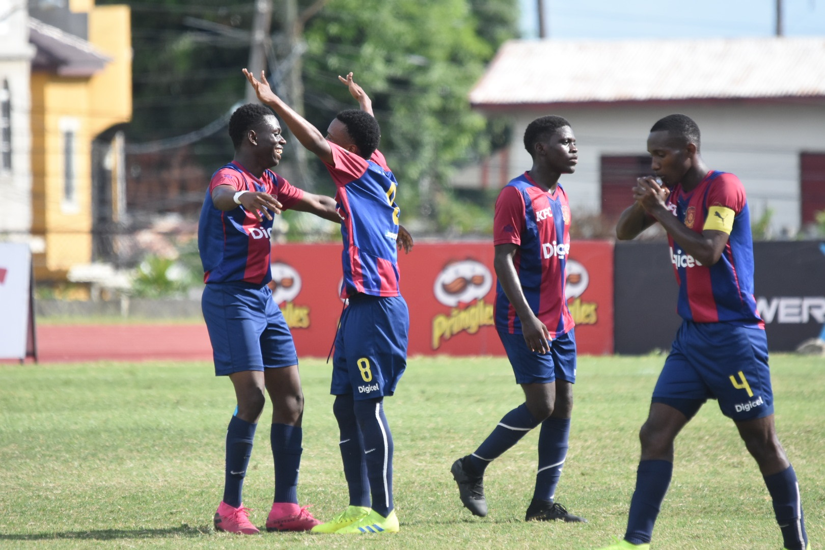 Mikel Riley (second right) of St Andrew Technical High School (STATHS) celebrates his goal with teammates during their Group H quarter-final match against Jamaica College (JC) at the Stadium East field on Tuesday, November 12, 2019. (PHOTOS: Marlon Reid).