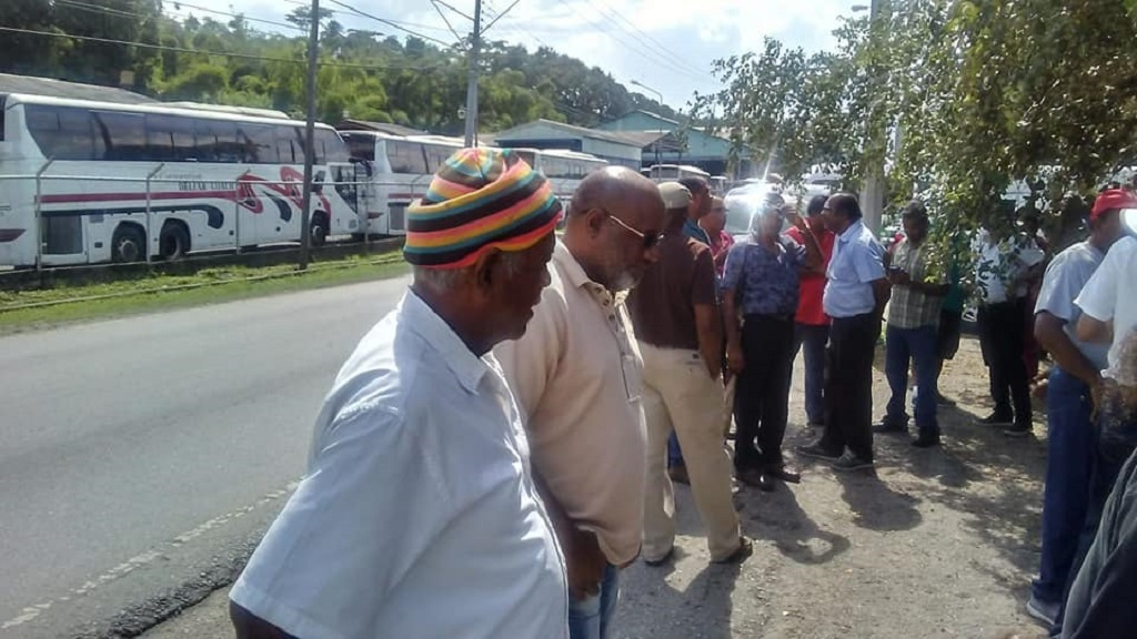 Maxi Taxi Association members protest on Lady Hayles Avenue, San Fernando, opposite PTSC Garage.