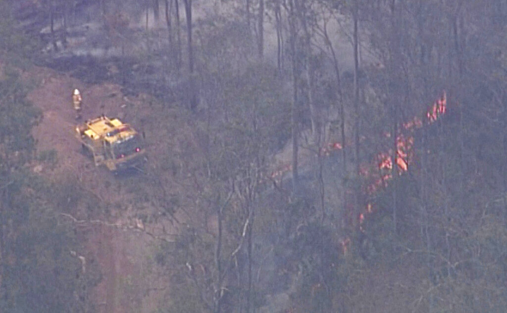 In this image made from video, forest trees are on fire in Kilkivan, Queensland state, Australia, November 13, 2019. (Australia Pool via AP)