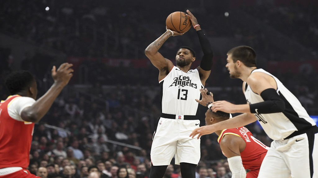 Los Angeles Clippers forward Paul George shoots against the Houston Rockets during the first half of an NBA basketball game Friday, Nov. 22, 2019, in Los Angeles. (AP Photo/Michael Owen Baker).