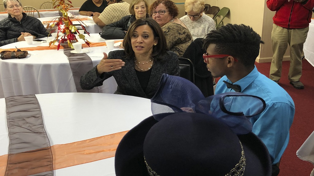 Democratic presidential candidate Senator Kamala Harris, speaks to DeVon Walker, 17, right, at a church congregation breakfast in Fort Dodge, Iowa, on November 10, 2019. (AP Photo/Kathleen Ronayne)