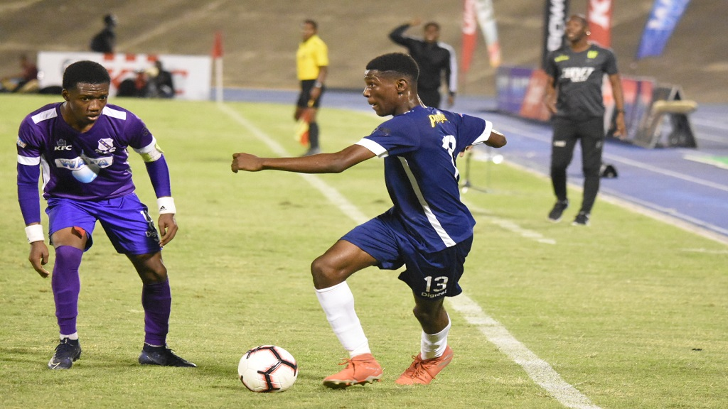Action from last Saturday's Champions Cup semi-final clash between Kingston College and Jamaica College at the National Stadium. (PHOTOS: Marlon Reid).