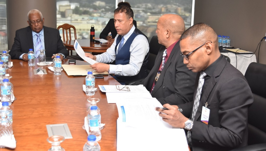 Education Minister Anthony Garcia (left); Police Commissioner Gary Griffith (second from right); Ministry officials.