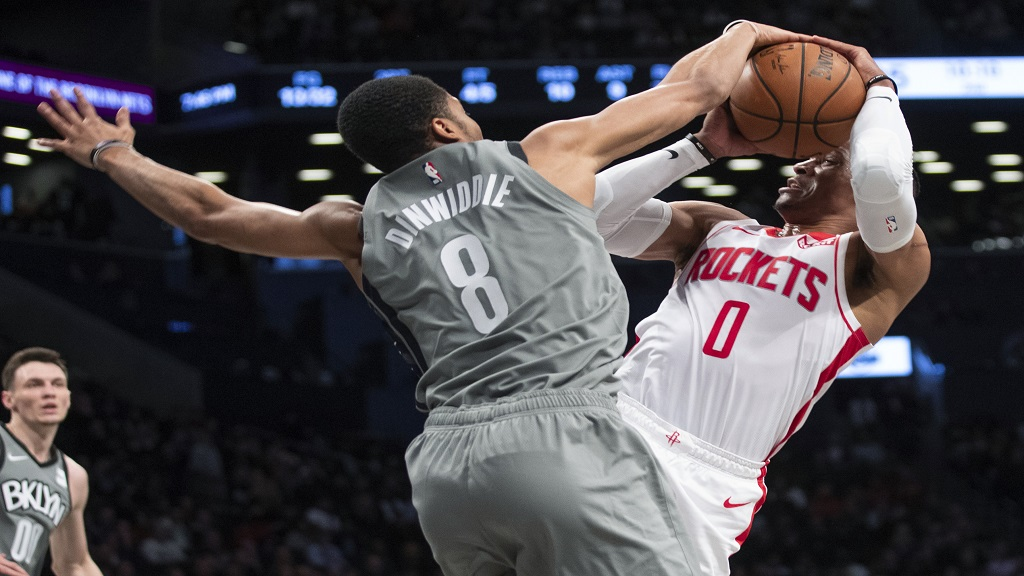 Brooklyn Nets guard Spencer Dinwiddie (8) guards Houston Rockets guard Russell Westbrook (0) during the first half of an NBA basketball game Friday, Nov. 1, 2019, in New York. (AP Photo/Mary Altaffer).