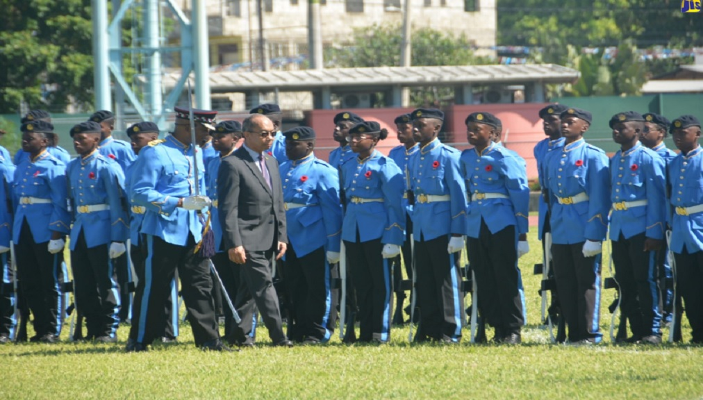 Minister of National Security, Dr Horace Chang (right, foreground), inspects members of the Jamaica Combined Cadet Force (JCCF), during the corps' 75th-anniversary closing parade and medal ceremony at the Montego Bay Sports Complex in St. James, on Sunday. He is accompanied by Parade Commander, Major John McKnight.