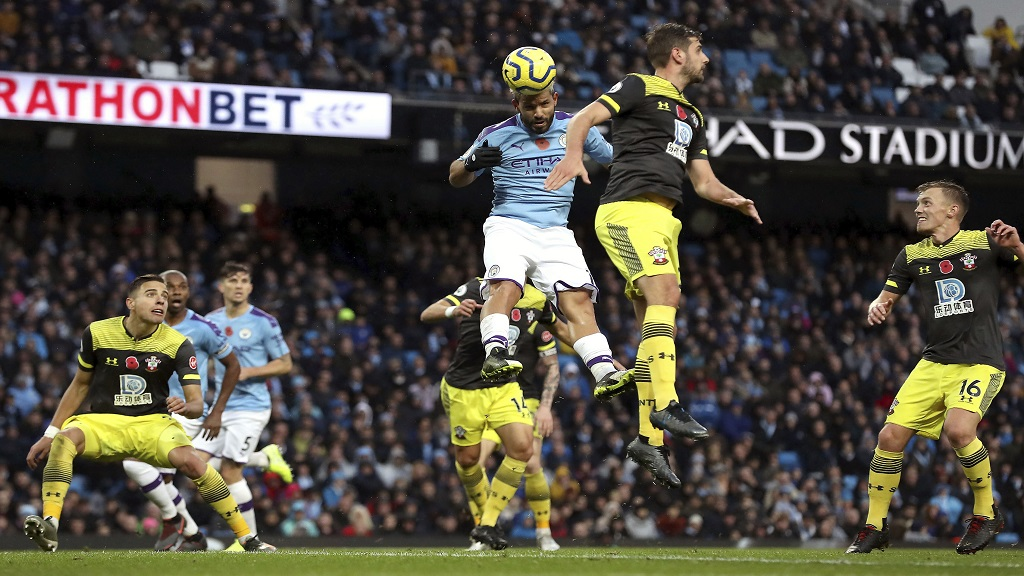 Manchester City's Sergio Aguero, top left, heads the ball during the English Premier League football match against Southampton at The Etihad Stadium, Manchester, England, Saturday Nov. 2, 2019. (Martin Rickett/PA via AP).