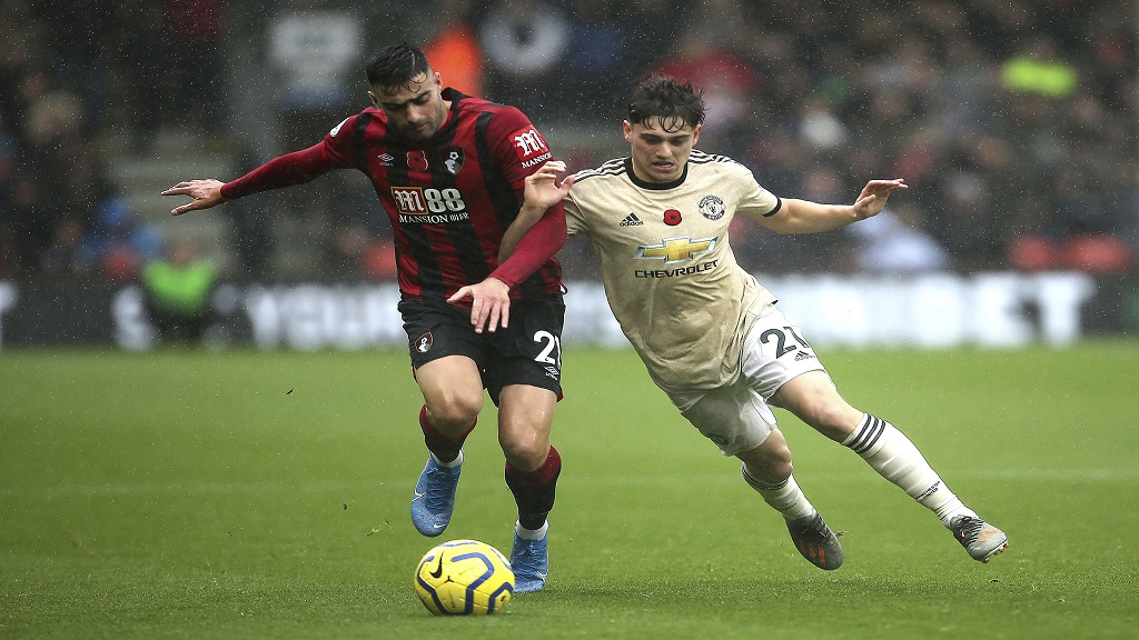 Bournemouth's Diego Rico, left, and Manchester United's Daniel James battle for the ball during the English Premiership football match at The Vitality Stadium, Bournemouth, England, Saturday Nov. 2, 2019. (Mark Kerton/PA via AP).