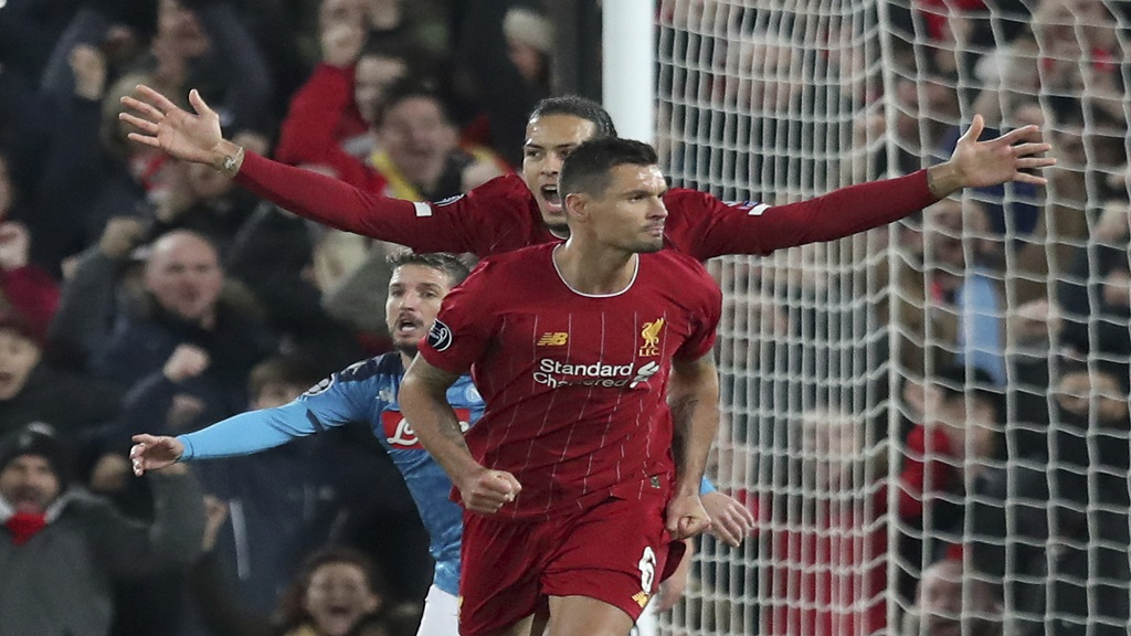 Liverpool's Dejan Lovren, front, celebrates scoring his side's first goal with Virgil van Dijk, arms outstretched, during the Champions League Group E football match against Napoli at Anfield stadium in Liverpool, England, Wednesday, Nov. 27, 2019. (AP Photo/Jon Super).