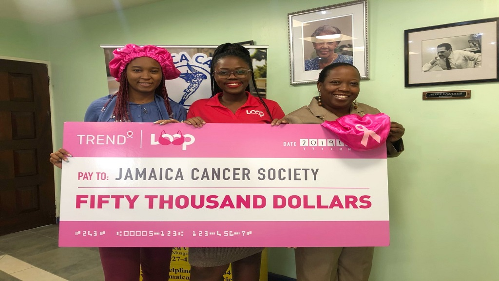 Loop News marketing assistant Shannon Bailey (centre) with Digicel employee Sidoney Gordon and Jamaica Cancer Society public relations officer, Shullian Brown, at last week's handover.