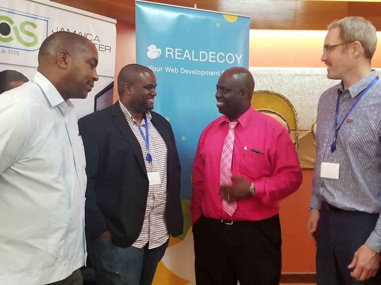 Opposition spokesman on technology Julian Robinson (Left), gives ear to CRMmetry CEO, Jordan
