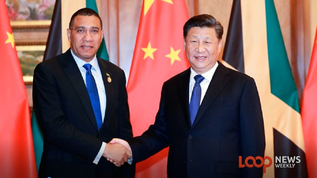 Prime Minister Andrew Holness (left) poses with President Xi Jingping of China during Holness' official working visit to the far eastern country.