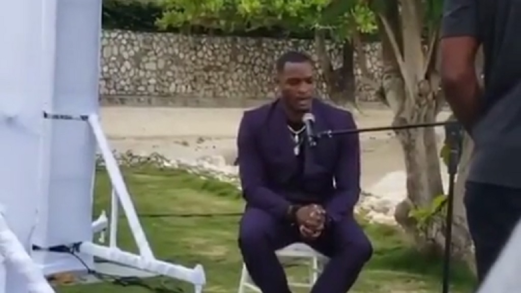 A screen grab from a video of top-flight Jamaican hurdler, Omar McLeod, singing at the recent wedding of his colleague, Elaine Thompson.