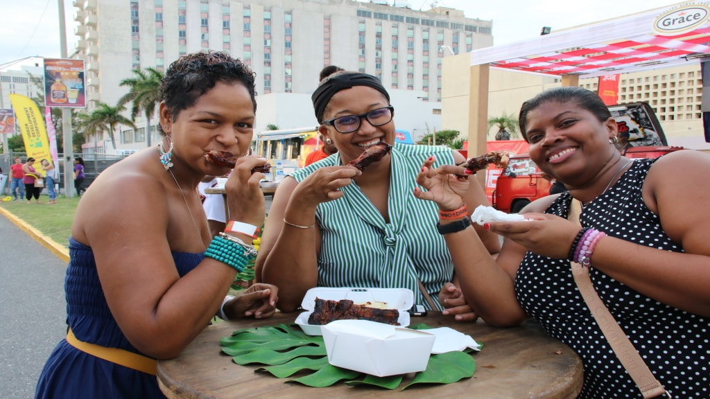 Patrons tuck into spare ribs on the Waterfront. (Photos: Llewelyn Wynter)