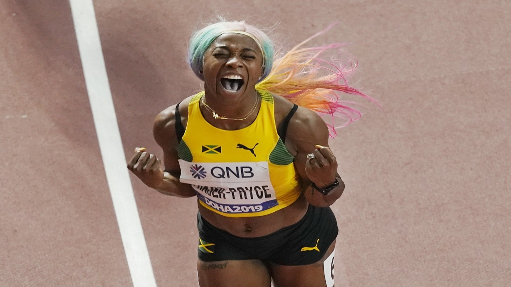 Shelly-Ann Fraser-Pryce, of Jamaica, celebrates after winning the women's 100m final at the World Athletics Championships in Doha, Qatar, Sunday, Sept. 29, 2019. (AP Photo/Nick Didlick).