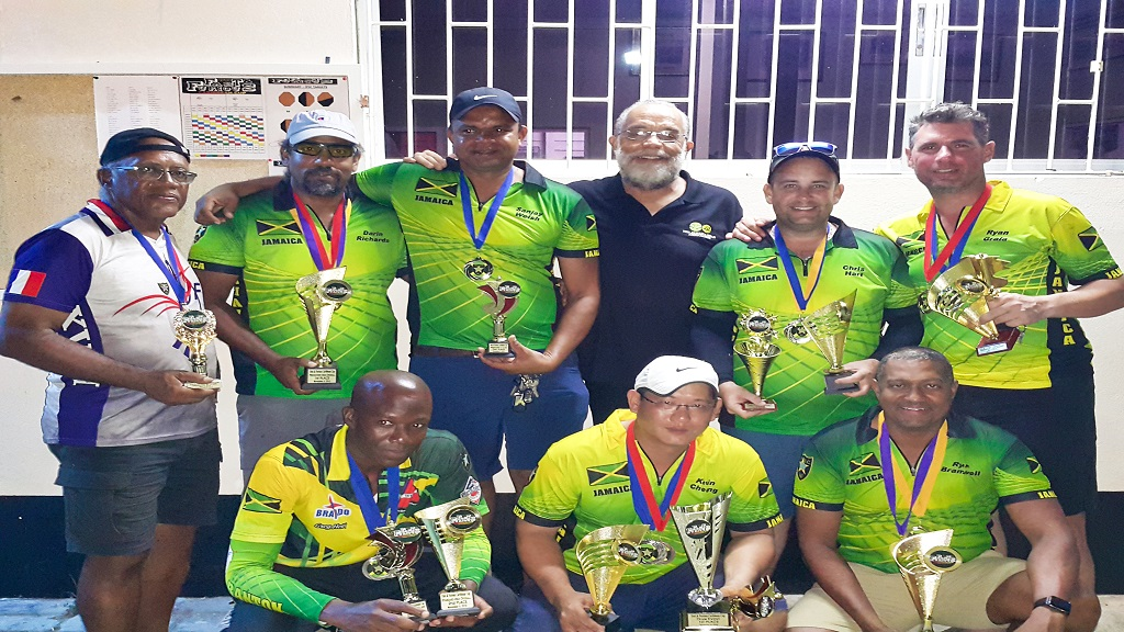 Members of the Jamaican team pose with their prizes after being announced as overall champions at the 2019 Caribbean Cup Pistol Shooting Championships at the Jamaica Rifle Association, headquarters in Kingston over the weekend.