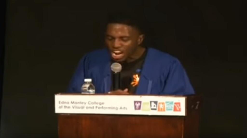 Waldane Walker addressing his fellow graduates.