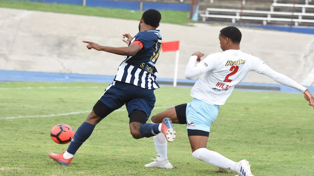 Jamaica College's Shaniel Thomas moves away from Tahy Hylton of St George's College during their Group B quarter-final round match in the 2019 ISSA/Digicel Manning Cup football competition at the National Stadium on Thursday, October 31. The teams battled to  1-1 draw. (PHOTOS: Marlon Reid).